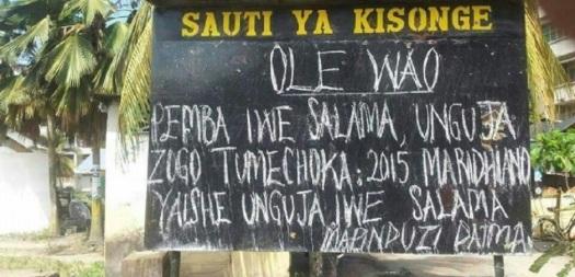 Mojawapo ya bango lenye ujumbe wa kuhamasisha chuki, kama linavyoonekana hapo muembe kisonge