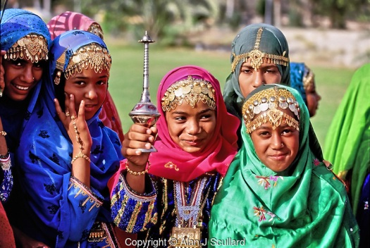 Omani girls wearing traditional jewellery at the National Day ce